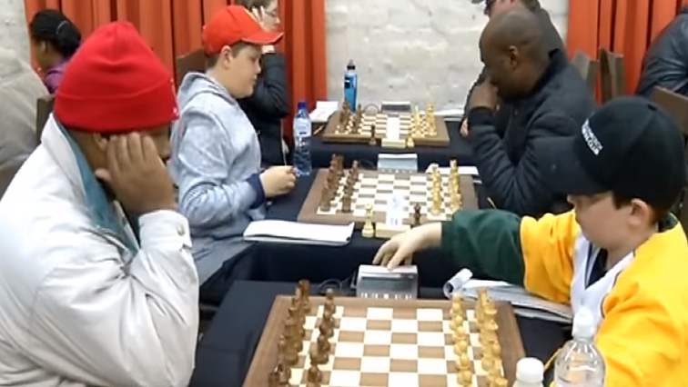 People participating in chess