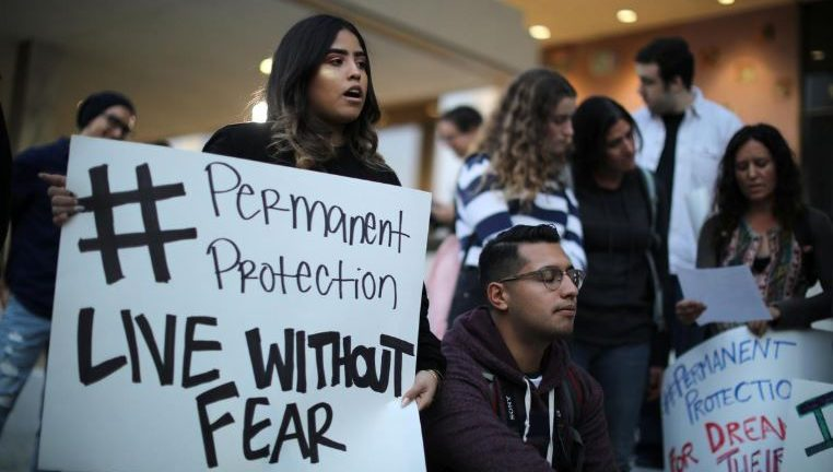 People protest to call for a new DREAM Act to replace DACA in Los Angeles, California.