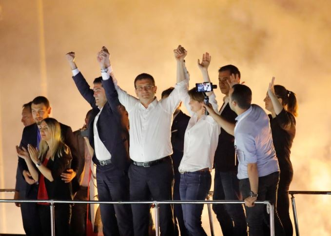 Ekrem Imamoglu, mayoral candidate of the main opposition Republican People's Party (CHP), greets supporters at a rally of in Beylikduzu district, in Istanbul, Turkey.