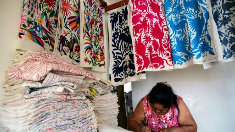 A women busy with cultural cloth