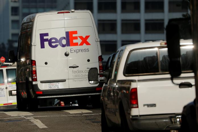 A Federal Express delivery truck is shown in downtown Los Angeles, California.