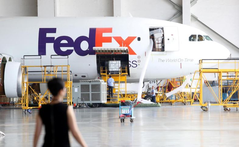 A FedEx Express plane is seen at a maintenance base of Guangzhou Aircraft Maintenance Engineering Company Limited (GAMECO) at the airport in Guangzhou.