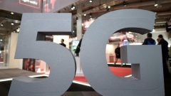 A logo of the upcoming mobile standard 5G is pictured at the Hanover trade fair, in Hanover.