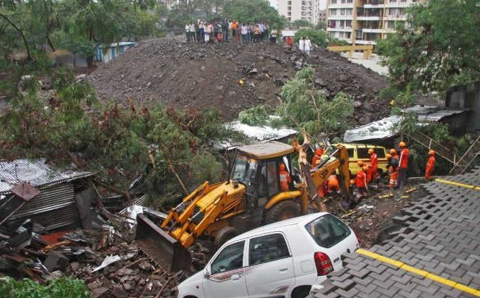 Rescue workers look for survivors among the debris of a collapsed wall of a residential complex in Pune, India.