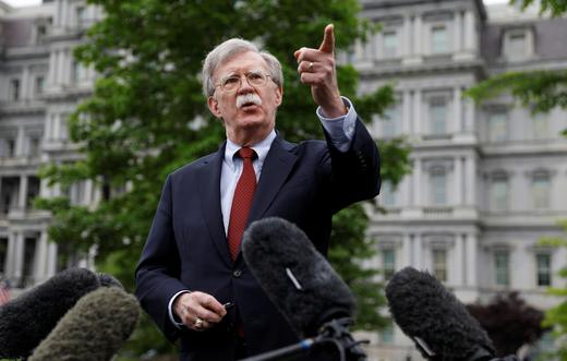 US national security adviser John Bolton talks to reporters at the White House in Washington