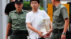 """Former student leader Joshua Wong walks out from prison after being jailed for his role in the Occupy Central movement, also known as """"Umbrella Movement"""", in Hong Kong."""