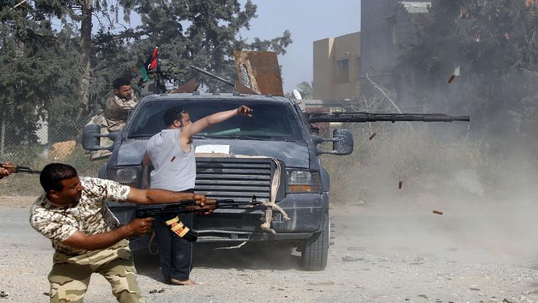 Armed men firing ammunition