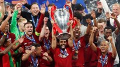 Soccer Football - Champions League Final - Tottenham Hotspur v Liverpool - Wanda Metropolitano, Madrid, Spain - June 1, 2019 Liverpool's Mohamed Salah lifts the trophy as they celebrate winning the Champions League.
