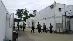 Authorities inside the Manus Island refugee camp in Papua New Guinea walk around the camp serving deportation notices to detainees.