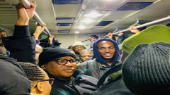 Fikile Mbalula standing in a train