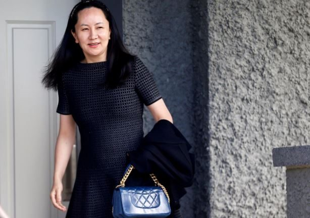 Huawei's Financial Chief Meng Wanzhou leaves her family home in Vancouver, British Columbia, Canada