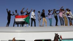 Protesters on a train from Atbara, the birthplace of an uprising that toppled Sudan's former President Omar al-Bashir.