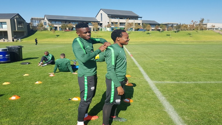 Percy Tau with teammate
