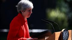 British Prime Minister Theresa May cries as she makes a statement, at Downing Street in London