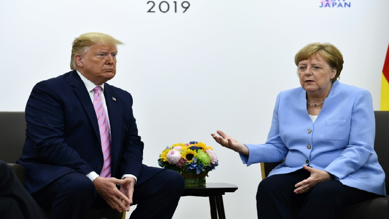 Trump struck a conciliatory tone in talks with Angela Merkel