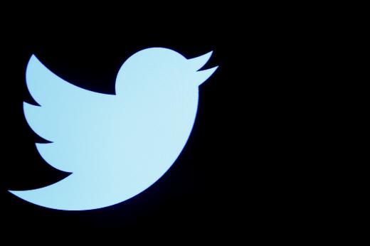 The Twitter logo is displayed on a screen on the floor of the New York Stock Exchange.