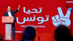 Tunisian Prime Minister Youssef Chahed waves during a meeting of the 'Long Live Tunisia' party in Tunis, Tunisia.