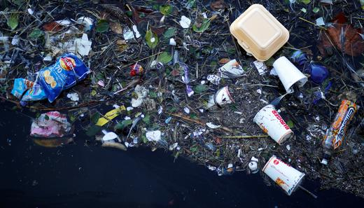Plastic and other waste is seen floating on the Marine Lake at New Brighton beach near Liverpool.