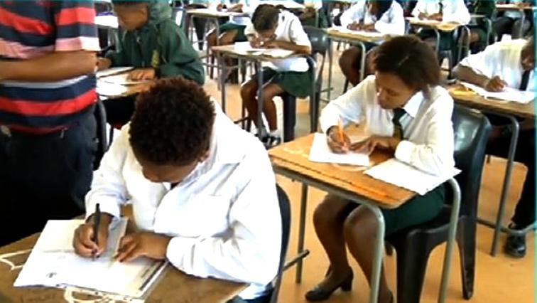 Scholars writing a matric exam