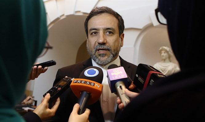 Iran's deputy foreign minister Abbas Araghchi addressing the media.
