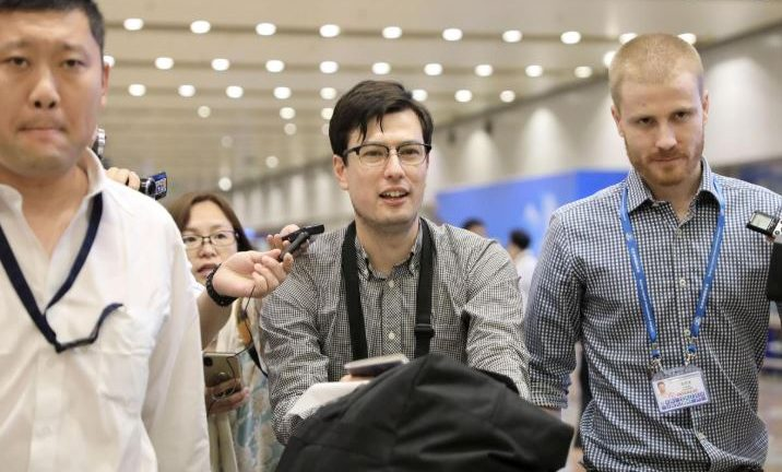 An Australian student Alek Sigley, 29, who was detained in North Korea, arrives at Beijing international airport in Beijing.