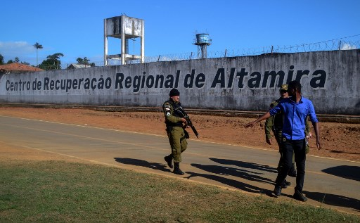 A police officer patrols the surroundings of the Altamira Regional Recovery Centre after t least 52 inmates were killed in a prison riot, in the Brazilian northern city of Altamira.