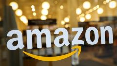 The logo of Amazon is seen on the door of an Amazon Books retail store in New York City