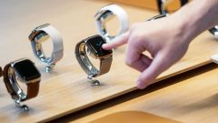 A customer checks Apple watches at the grand opening of the new Apple Carnegie Library store in Washington.