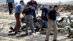 American civil aviation and Boeing investigators search through the debris at the scene of the Ethiopian Airlines Flight ET 302 plane crash.