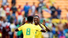 South Africa's Bongani Zungu congratulates Sibusiso Vilakazi.