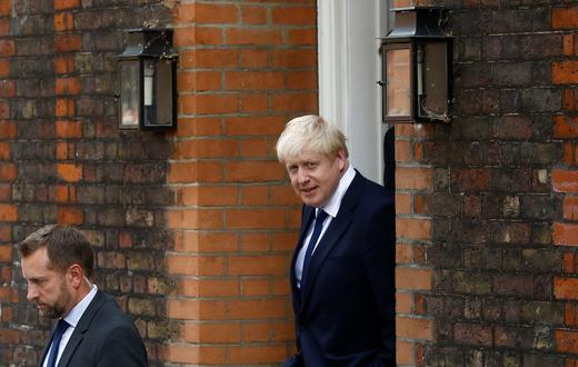 Boris Johnson, a leadership candidate for Britain's Conservative Party, leaves his office in London.