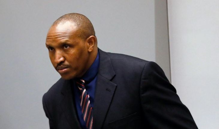 Congolese warlord Bosco Ntaganda stands in the courtroom of the ICC