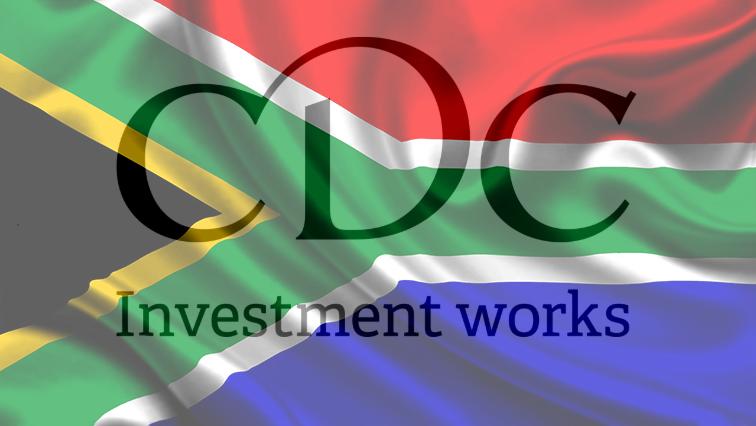SA and CDC Group flag