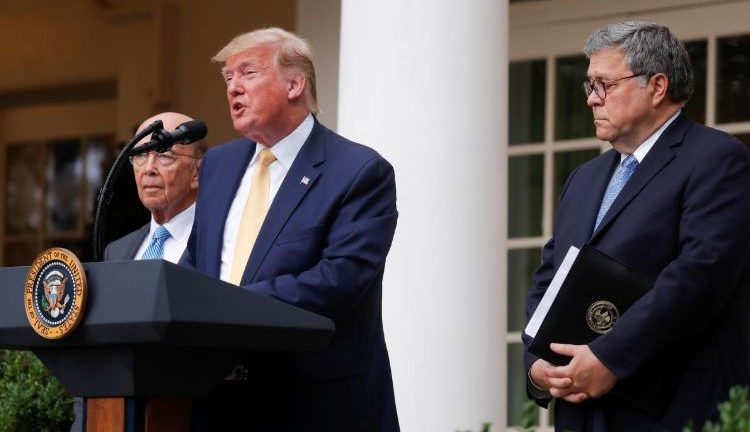 U.S. President Donald Trump stands with Commerce Secretary Wilbur Ross and Attorney General Bill Barr to announce his administration's effort to add a citizenship question to the 2020 census during an event in the Rose Garden of the White House.