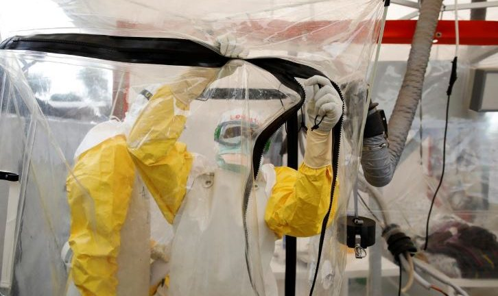 A health worker wearing Ebola protection gear enters the Biosecure Emergency Care Unit (CUBE) at the ALIMA (The Alliance for International Medical Action) Ebola treatment centre in Beni, in the Democratic Republic of Congo.