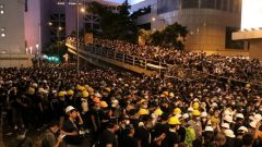 Protesters gather outside police headquarters in Hong Kong.