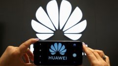 A Huawei logo is seen on a cell phone screen in their store at Vina del Mar.