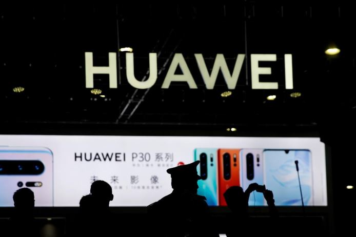 A Huawei company logo is seen at CES (Consumer Electronics Show) Asia 2019 in Shanghai.
