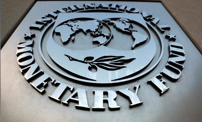The International Monetary Fund (IMF) logo is seen outside the headquarters building in Washington.