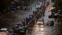 At least 14 dead as Mumbai hit by flooding Severe disruption caused after India's financial capital hit by month's rainfall in a day Wed, Aug 30, 2017, 10:41 Updated: Wed, Aug 30, 2017, 18:52 Commuters walk through water-logged roads after rains in Mumbai on Tuesday. Photograph: Shailesh Andrade/Reuters Commuters walk through water-logged roads after rains in Mumbai on Tuesday.