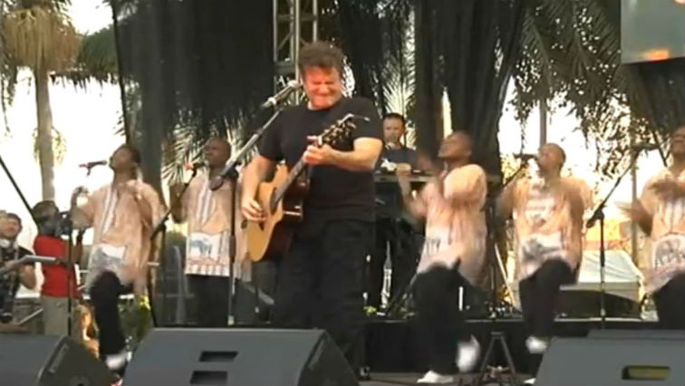 Johnny Clegg playing his guitar