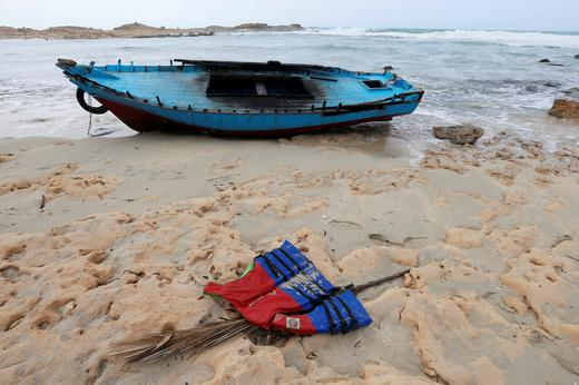 A boat used by migrants is seen near the western town of Sabratha.