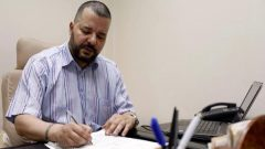 Tunisian LGBT+ activist and presidential candidate Mounir Baatour works in his office in Tunis, Tunisia.