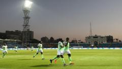 Nigerian football players running on the field