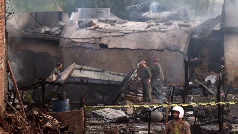 Pakistani soldiers cordon off the site where an aircraft crashed in Rawalpindi.