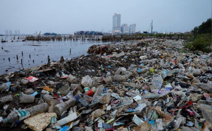Rubbish, most of which is plastics, is seen along a shoreline in Jakarta, Indonesia.