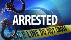 Police handcuffs and yellow crime scene tape