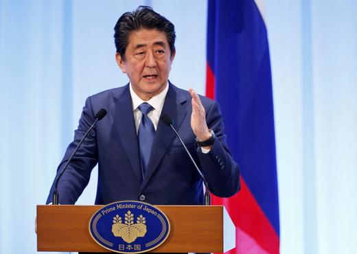 Japanese Prime Minister Shinzo Abe speaks during his meeting with Russian President Vladimir Putin in Osaka.