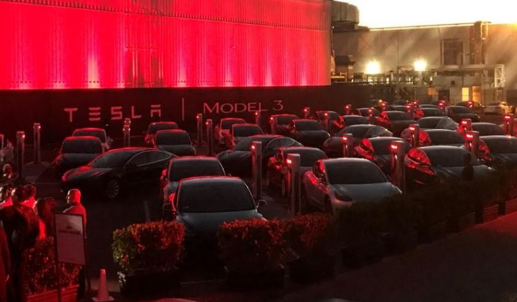 Tesla Model 3 cars wait for their new owners as they come off the Fremont factory's production line during an event at the company's facilities in Fremont.