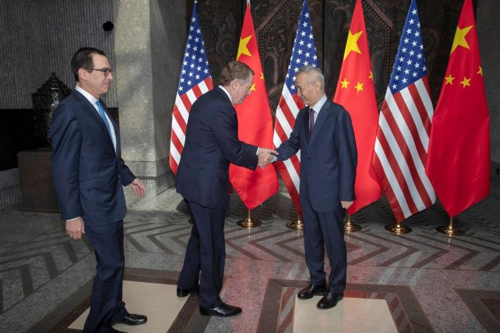 Chinese Vice Premier Liu He, at right welcomes United States Trade Representative Robert Lighthizer, center and Treasury Secretary Steve Mnuchin, at left before holding talks at the Xijiao Conference Center in Shanghai.